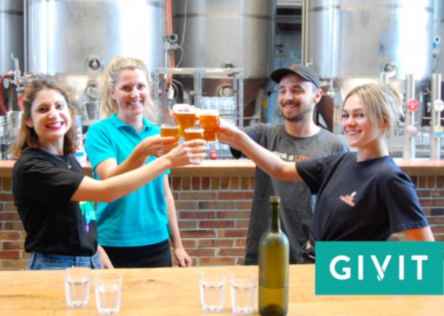 Little Creatures staff 'cheersing' in the brewery