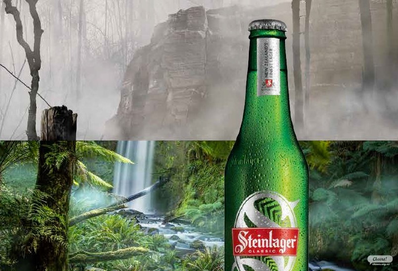 Steinlager carbon zero - beer in front of rainforest, half destroyed half preserved